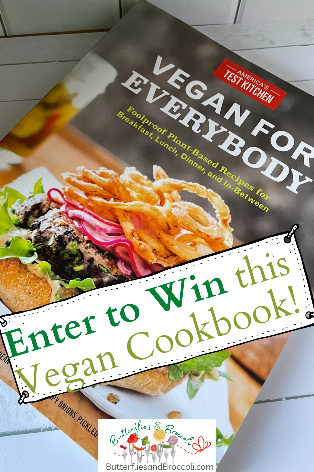 """Image of cookbook """"vegan for everybody"""" with text """"Enter to win this vegan cookbook"""""""