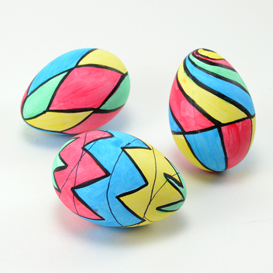 vegan Easter egg alternatives stained glass eggs. Image of colorful hand colored wooden eggs.