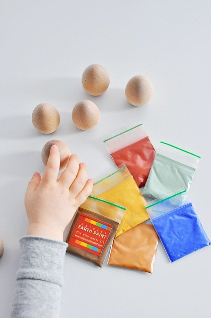 vegan Easter egg alternatives image of wooden eggs with packets of colored paint.